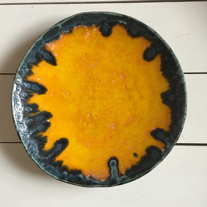 Yellow large ceramic fruit bowl with retro lava edge detail